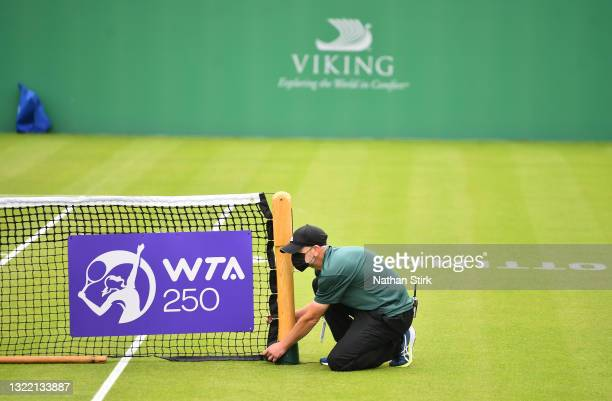 Member of staff prepares the court after rain stops play during day 2 of the Viking Open at Nottingham Tennis Centre on June 06, 2021 in Nottingham,...