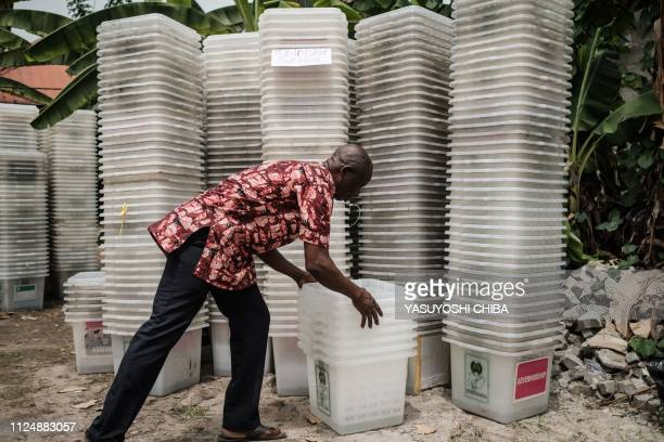 A member of staff separates ballot boxes before delivered to polling stations ahead of Nigeria's Presidential election at an office of Independent...