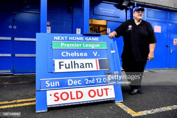 A member of staff stands next to a sign showing that the match is sold out during the Premier League match between Chelsea FC and Fulham FC at...