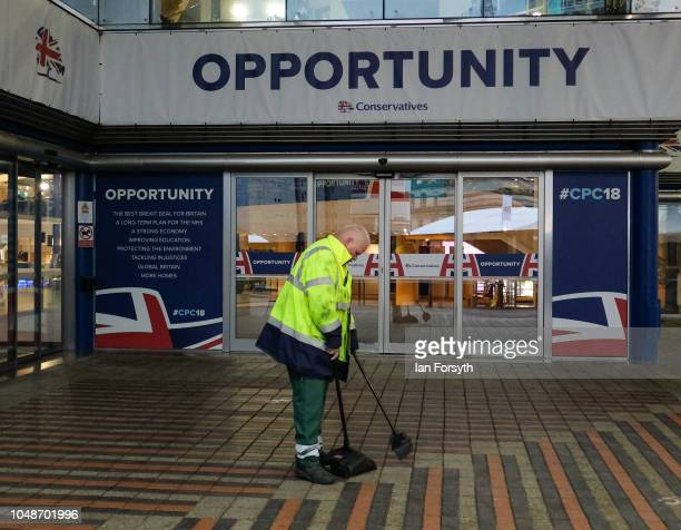A member of staff sweeps the entrance way on the final day of the Conservative party Conference at the International Convention Centre on October 3...