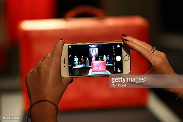 A member of staff takes a photograph of a 'Prime Ministerial Red Morocco Dispatch Box' during a press preview at Christies auction house on December...