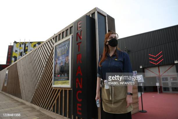 Member of staff waits to greet theatregoers ahead of a performance of Sleepless the Musical at the Troubadour Wembley Park Theatre in London on...
