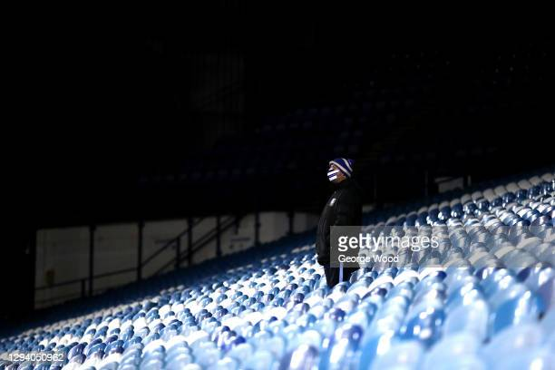 Member of staff wearing a face mask looks on from an empty stand during the Sky Bet Championship match between Sheffield Wednesday and Derby County...