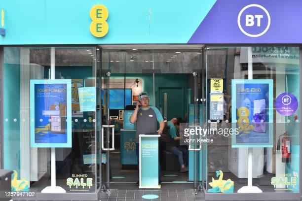 Member of staff wearing a face shield controls the amount of customers entering a EE BT mobile phone shop on July 24, 2020 in Southend on Sea,...
