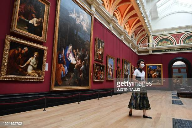 Member of staff wearing a protective face mask moves through a room inside the National Gallery on July 4 as the gallery prepares to reopen on July 8...
