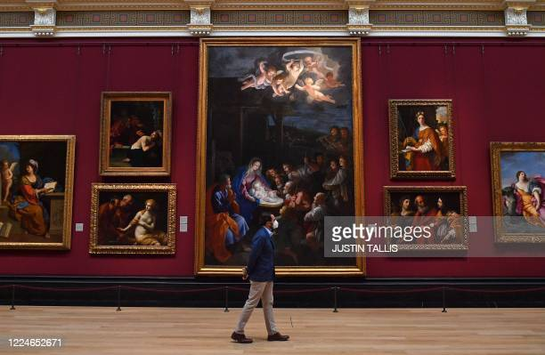 Member of staff wearing a protective face mask patrols a room inside the National Gallery on July 4 as the gallery prepares to reopen on July 8...
