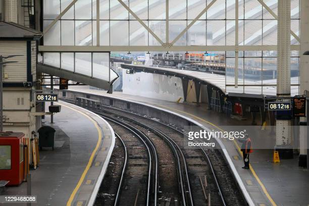 Member of station staff stands on an empty platform at London Waterloo railway station in London, U.K., on Thursday, Nov. 5, 2020. The Bank of...