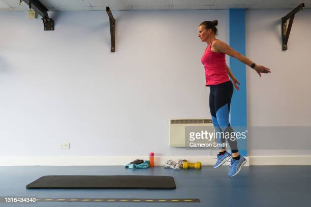 Member of Stringer's Gym takes part in a fitness class on May 17, 2021 in Truro, England. England implements the third step in its road map out of...