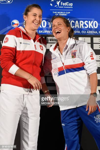 Member of Swiss Fed Cup team Belinda Bencic and member of Czech Fed Cup team Barbora Strycova react after the International Tennis Federation Fed Cup...