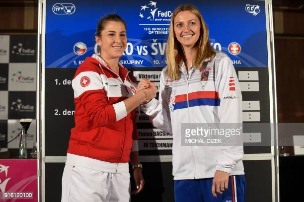 Member of Swiss Fed Cup team Belinda Bencic shakes hand with member of Czech Fed Cup team Petra Kvitova after the International Tennis Federation Fed...