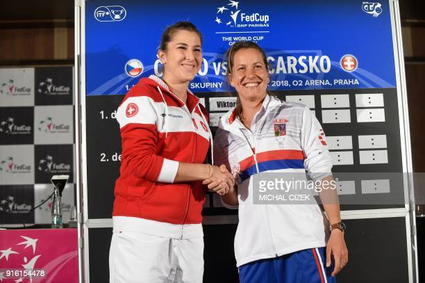 Member of Swiss Fed Cup team Belinda Bencic shakes hand with member of Czech Fed Cup team Barbora Strycova after the International Tennis Federation...