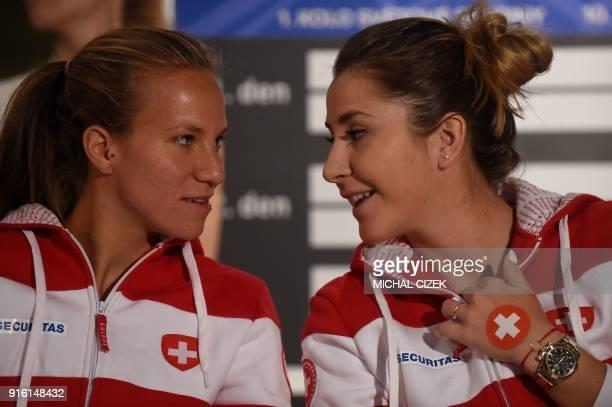 Member of Swiss Fed Cup team Belinda Bencic talks with her team mate Viktorija Golubic during the International Tennis Federation Fed Cup draw...