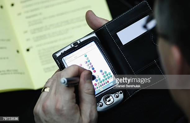 A member of Synod plays a game of Tetris during the General Synod February Sessions on February 12 2008 in London England The Archbishop of...