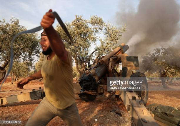 Member of Syria's opposition National Liberation Front fires a 155mm gun toward positons of Russian and regime forces on October 28 in retaliation to...