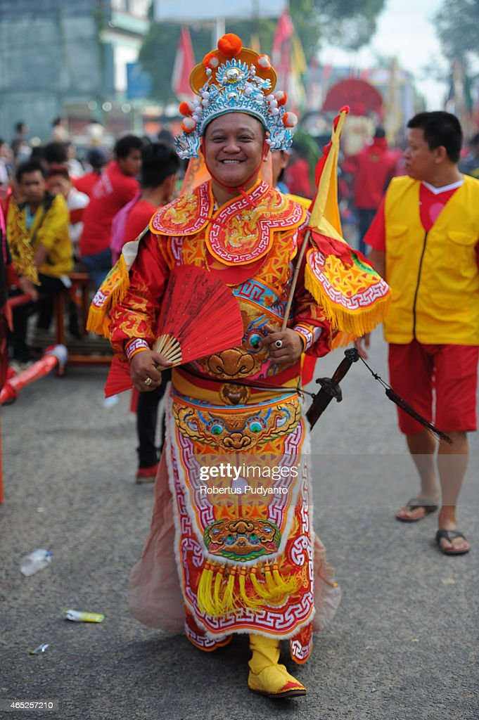 SINGKAWANG, KALIMANTAN, INDONESIA - MARCH 05: A member of Tatung performs during Cap Go Meh celebrations on March 5, 2015 in Singkawang, Kalimantan, Indonesia. The ancient art of Tatung, performed as part of the Cap Go Meh Festival, is believed to call upon positive spirit who help to dispel the bad spirits that may affect people's lives. Cap Go Meh Festival also know as the Lantern Festival is celebrated on the 15th day of the Chinese Lunar Year and marks the end of Chinese New Year celebrations.