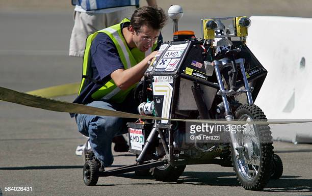 A member of Team Blue gets the world's first autonomous motorcycle ready for its qualifying run during the DARPA National Qualification Event at the...