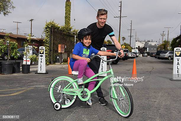 Member of team Sky Danny Van Poppe met kids from the Boys & Girls Club of South Bay test out their new bicycles in an interactive cycling course with...