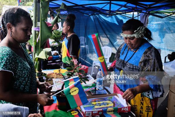 A member of the 150 years committee sells merchandising bearing the image of the independence movement during a symbolic day marking the taking of...