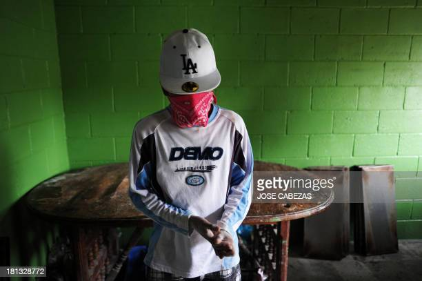 A member of the 18th street gang works in a gangoperated bakery as part of a rehabilitation program for gangsters during a visit of participants in...