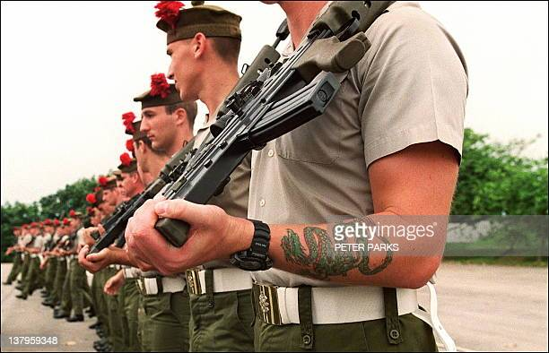 A member of the 1st Battalion The Black Watch sports a Chinese dragon tattoo on his forearm 19 June during a parade rehearsal for the Hong Kong...