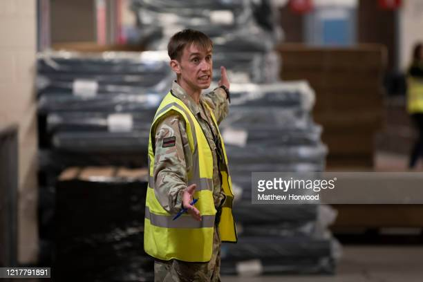 Member of the 1st Battalion The Rifles gives orders in the Dragon's Heart hospital on April 9 in Cardiff, Wales. The Principality Stadium is being...