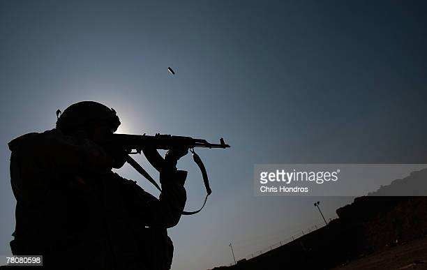 A member of the 269 Armored Battalion of the 3rd Infantry Division fires an AK47 assault rifle during target practice November 24 2007 in Baghdad...