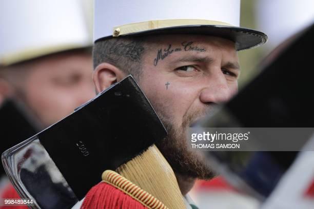 TOPSHOT A member of the 2e Regiment Etranger d'Infanterie de la Legion Etrangere wears a tattoo with the legion's motto 'March or Die' Marche ou...
