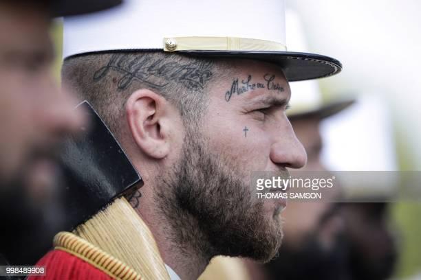A member of the 2e Regiment Etranger d'Infanterie de la Legion Etrangere wears a tattoo with the legion's motto 'March or Die' Marche ou Creve' as he...