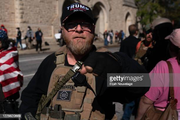 Member of the 3% militia group and supporter of President Trump, rallies against the election results outside the Georgia State Capitol on November...