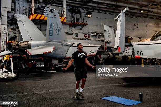 A member of the 330 meters aircraft carrier Harry S Truman works out under the deck of the warship on eastern Mediterranean Sea on May 8 2018 Sailing...