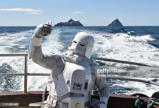 A member of the 501st Garrison dressed as a snowtrooper takes a selfie as he sails around Skellig Michael on May 4 2019 in Portmagee Ireland The...