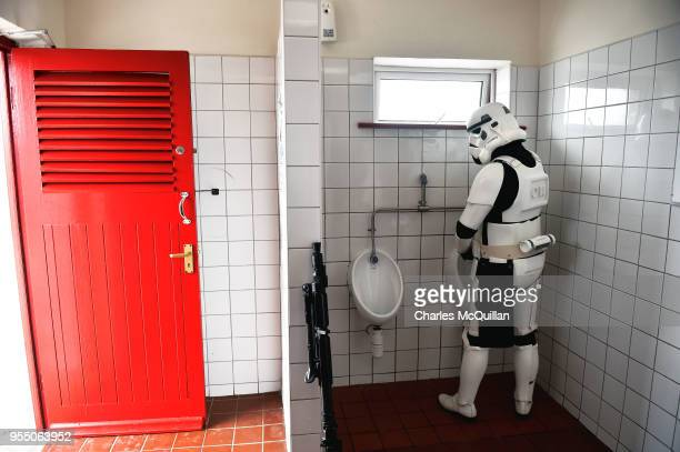 A member of the 501st Irish Legion dressed as a stormtrooper attempts to go to the bathroom on May 5 2018 in Portmagee Ireland The first ever Star...