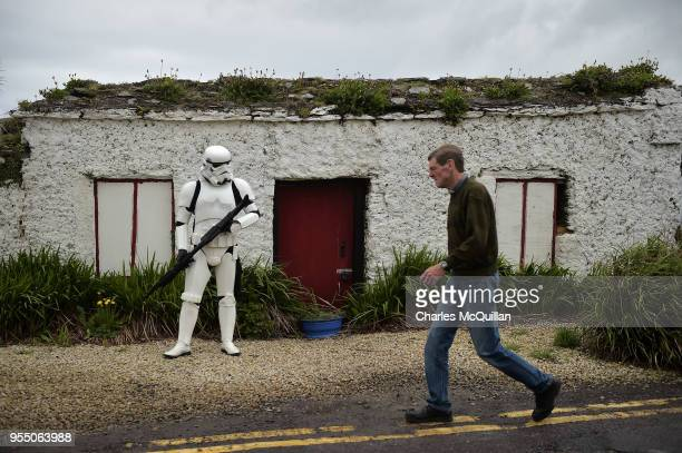 A member of the 501st Irish Legion dressed as a stormtrooper stands guard on May 5 2018 in Portmagee Ireland The first ever Star Wars festival is...