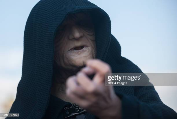 A member of the 501st Legion Spanish Garrison dressed as 'Darth Sidious' from the movie saga Star Wars performs during a charity parade in favour of...