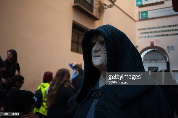A member of the 501st Legion Spanish Garrison dressed as 'Darth Sidious' from the movie saga Star Wars looks on as he performs during a charity...
