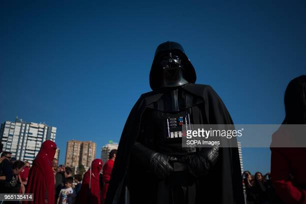 A member of the 501st Legion Spanish Garrison dressed as 'Darth Vader' from the movie saga Star Wars performs during a charity parade in favour of...