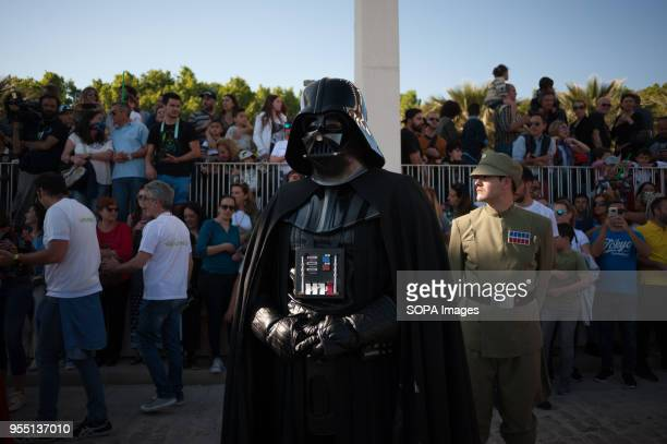 A member of the 501st Legion Spanish Garrison dressed as 'Darth Vader' from the movie saga Star Wars performs as spectators watch the parade during a...
