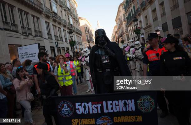 A member of the 501st Legion Spanish Garrison dressed as 'Darth Vader' from the movie saga Star Wars performs at Calle Larios street during a charity...