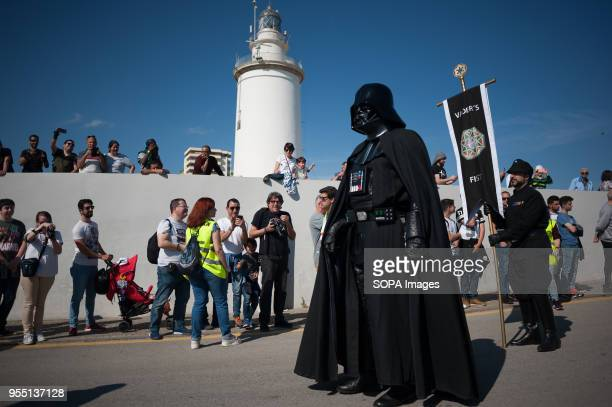 A member of the 501st Legion Spanish Garrison dressed as 'Darth Vader' from the movie saga Star Wars walks past as he performs during a charity...