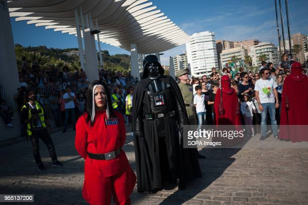 A member of the 501st Legion Spanish Garrison dressed as 'Darth Vader' from the movie saga Star Wars stands as he performs during a charity parade in...