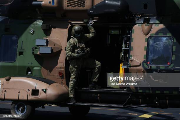 Member of the 5th Aviation Regiment, Townsville is seen aboard a MRH-90 Taipan arriving at Taree Airport as part of flood recovery and assist duties...