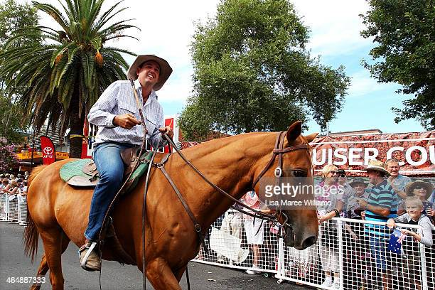 A member of the ABCRA National Rodeo rides his horse along Peel Street during the 42nd Tamworth Coutry Music Festival Cavalcade on January 25 2014 in...