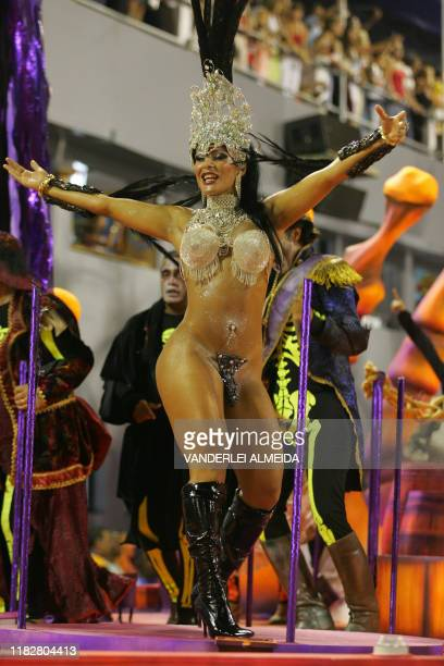Member of the Academicos do Salgueiro samba school performs as this school opens the first night of Rio de Janeiro's Carnival parade at the...