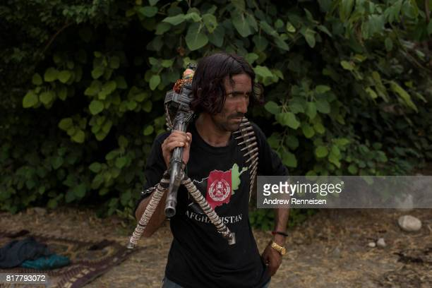 A member of the Afghan Local Police holds his weapon in the Momand Valley on July 16 2017 in Achin District Afghanistan The area is where the United...