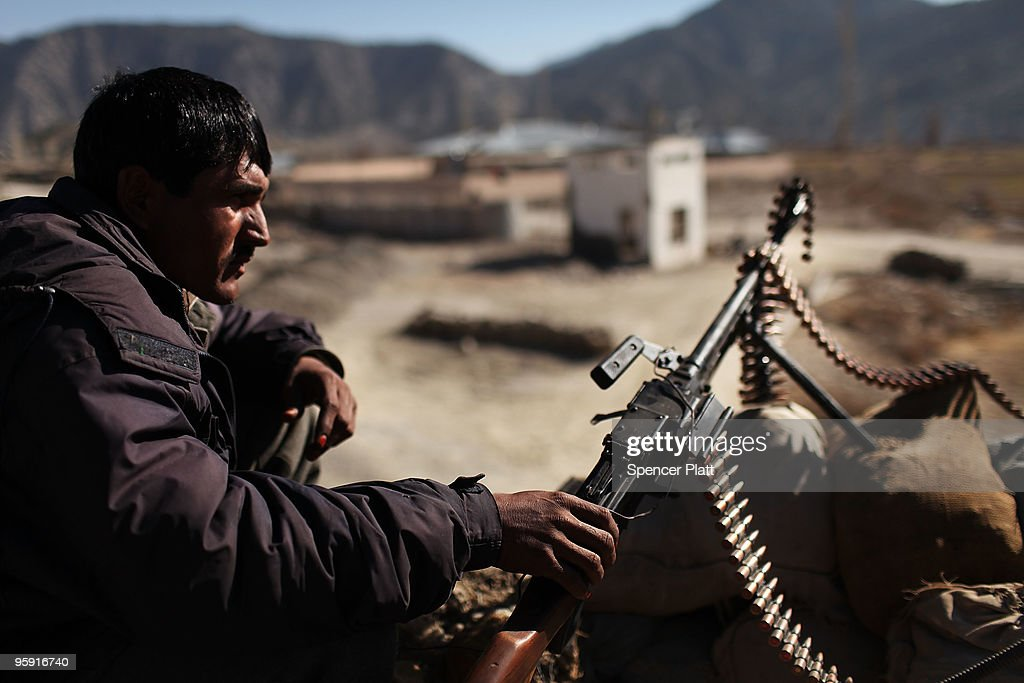 A member of the Afghan National Police (ANP) keeps watch outside of the district center beside Combat Outpost (COP) Zerak on January 21, 2010 in Zerak, Afghanistan. COP Zerak, located in Paktika Province, works disrupting and suppressing Taliban routes into Afghanistan from neighboring Pakistan. The province, which is roughly the size of Vermont, shares a restive and porous 600 kilometer border with Pakistan.