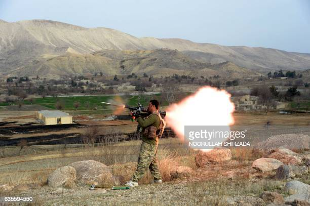 A member of the Afghan security force fires a rocketpropelled grenade launcher during an ongoing an operation against Islamic State militants in Kot...