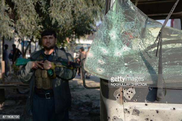 A member of the Afghan security forces stands guard near the site of a suicide attack in Jalalabad on November 23 2017 A suicide bomber struck at a...