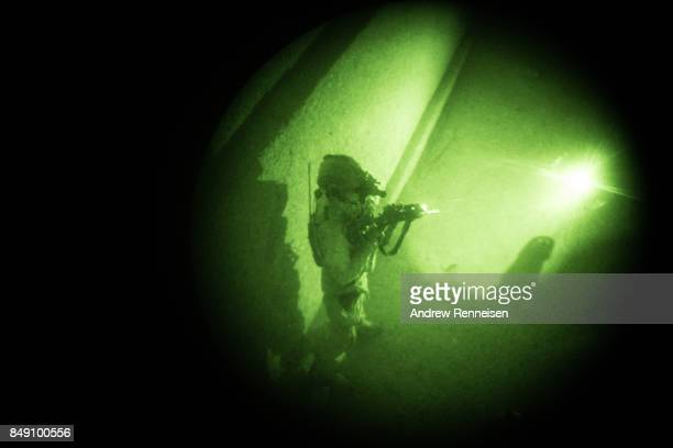 A member of the Afghan Special Forces is seen through a night vision goggle during casevac night training of Afghanistan Special Forces by the United...