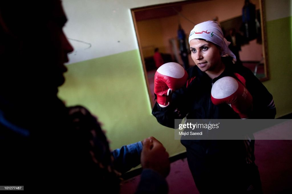 pashtun tribesmen and children living on the outskirts of kabul  a member of the women s national boxing team attends a training session at the national