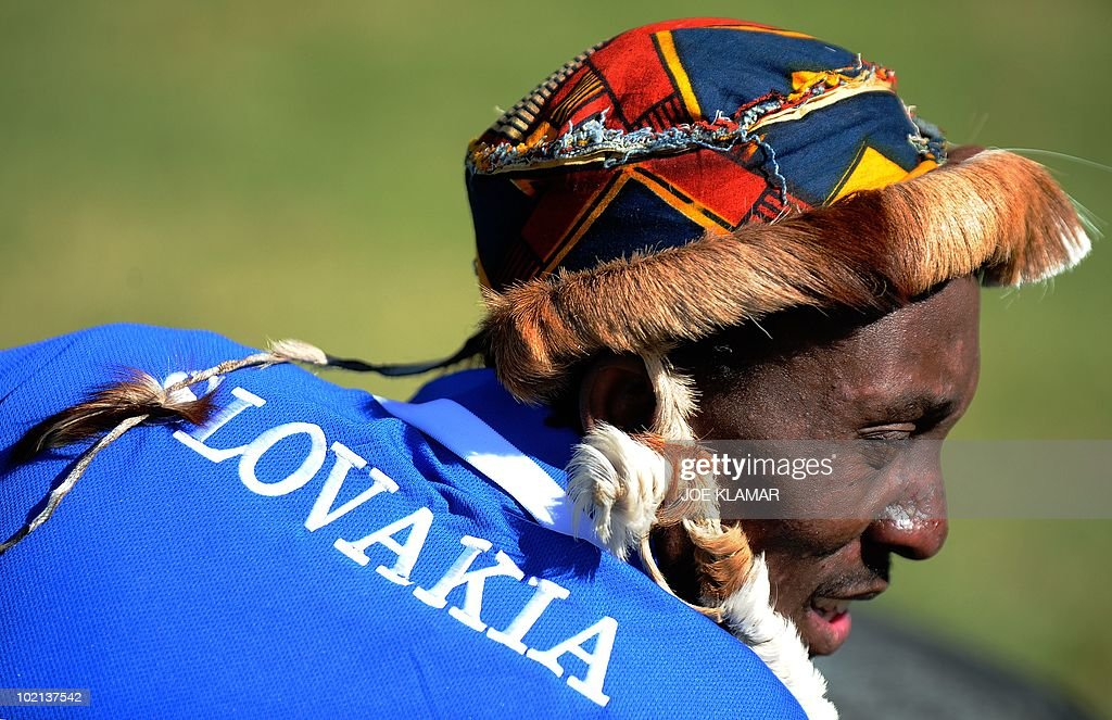 A member of the Akwaaba musical band, wearing a Slovak jersey, performs during the visit of Slovakia's National Football team at Pretoria Country Club on June 16, 2010 during the 2010 World Cup football tournament in South Africa.